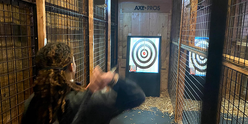 The latest trend axe throwing at The Den
